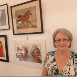 Vicki with her artwork